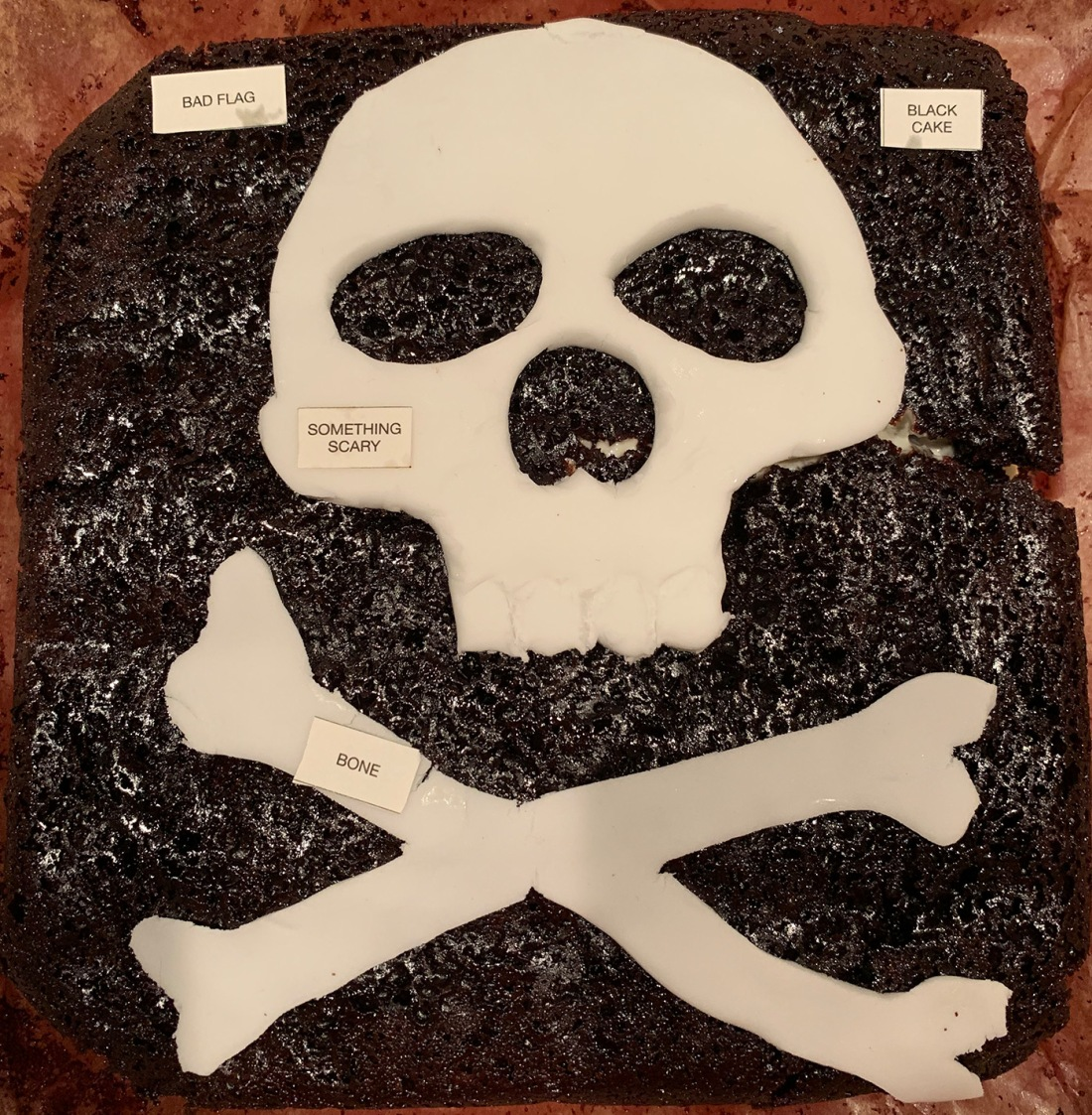Bad Flag Something Scary Black Cake Bone Cropped (1)